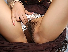 Yua Aida sexy Asian model enjoys showing her firm tits and hairy pussy
